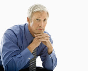 Middle aged Caucasian man with thoughtful expression.